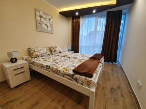 A bed or beds in a room at Vilotic group, Apartman 3