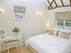 Ліжко або ліжка в номері Waters Edge