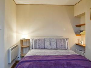 A bed or beds in a room at Toab