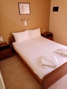 A bed or beds in a room at John Apartments