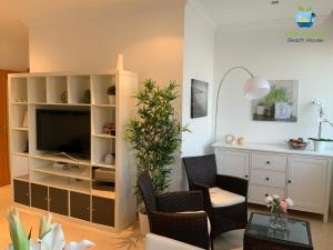 A television and/or entertainment center at The Apples - Beach House