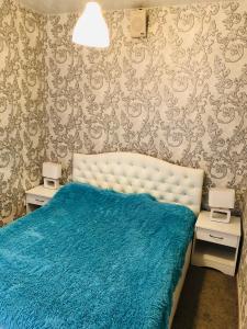 Кровать или кровати в номере Apart Piter