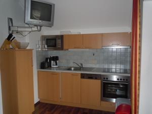 Кухня или мини-кухня в Haus Heigl