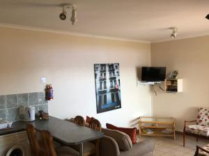 A television and/or entertainment centre at Adagio Luxury Self Catering