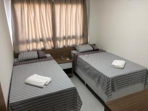 Cama ou camas em um quarto em Veranno Di Porto-50mts Piscinas Naturais