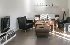 Ein Sitzbereich in der Unterkunft Ferienhaus Hafenstr. L
