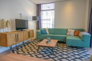 A seating area at Best Western Apartments Groningen Centre