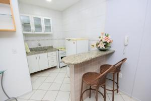 A kitchen or kitchenette at Residencial BoaVida