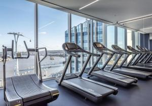 The fitness center and/or fitness facilities at Luxury apartment North Greenwich O2 arena