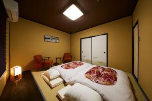 A bed or beds in a room at Rinn Yasaka Kodaiji