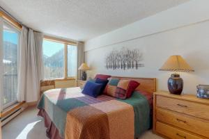 A bed or beds in a room at Pines Condominiums 2095