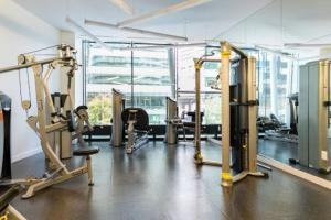 The fitness center and/or fitness facilities at Luxury Waterfront Condo in the Clouds w/ Parking