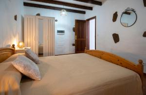 A bed or beds in a room at CASA BELÉN