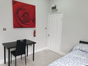 A bed or beds in a room at Dodi Apartment