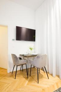 A television and/or entertainment centre at The Flats Apartments - Naschmarkt
