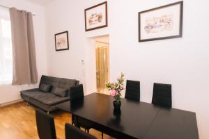 אזור ישיבה ב-Amici Apartments Hermine