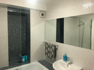 A bathroom at Whiskey Corner - City Center + Parking