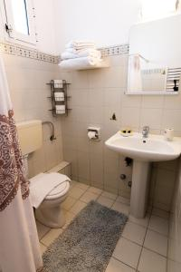 A bathroom at Anthos Apartments