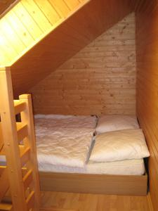 A bed or beds in a room at Penzión - Tempo