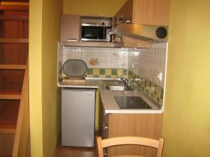 A kitchen or kitchenette at Penzión - Tempo