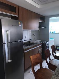 A kitchen or kitchenette at Apartamento Praia Dos Milionários