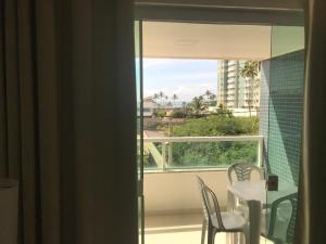 A balcony or terrace at Apartamento Praia Dos Milionários