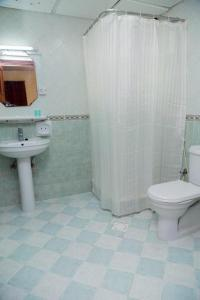 A bathroom at Sahara Hotel Apartments