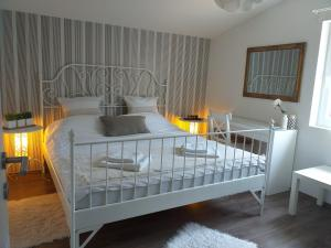 A bed or beds in a room at Laganini
