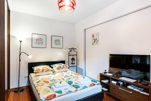 Postelja oz. postelje v sobi nastanitve HappyGuests Apartments
