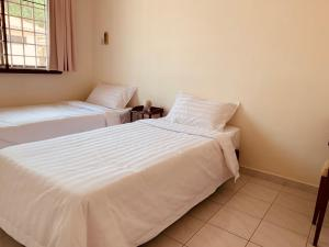 A bed or beds in a room at Home91 IJM Sandakan Taman Utama