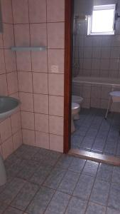 A bathroom at Apartments Dodik