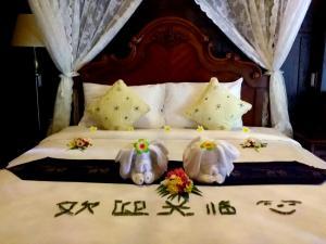 Postel nebo postele na pokoji v ubytování Sasitara Thai Villas