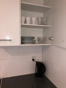 A kitchen or kitchenette at White Moon Apartment