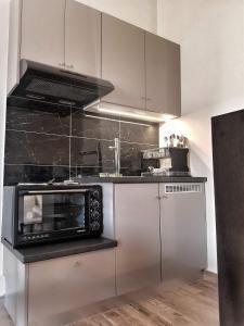 Η κουζίνα ή μικρή κουζίνα στο Meteora House- Cozy Living