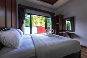 A bed or beds in a room at Wanna Dream Pool Villas Ao Nang