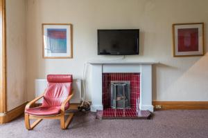 A television and/or entertainment center at Meadowlets Apartment