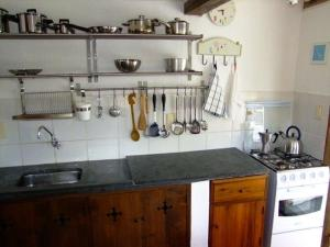 A kitchen or kitchenette at Minha Casa