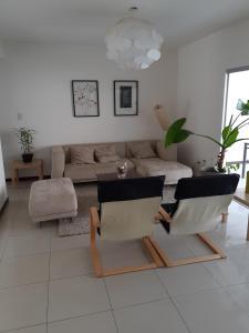 A seating area at Comoda Casa Condominio 8 pers.3 Dorm.3 Baños