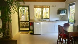 A kitchen or kitchenette at Wharepuke Subtropical Accommodation