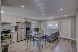 A kitchen or kitchenette at Morden 2 Bedrooms Private Suite