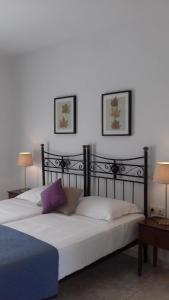 Ένα ή περισσότερα κρεβάτια σε δωμάτιο στο Aegean Blue Studios