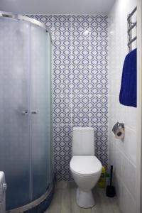 A bathroom at Apartment 1st Trekhgorka