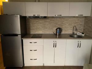 A kitchen or kitchenette at Batumi Orbi Plaza Apartment