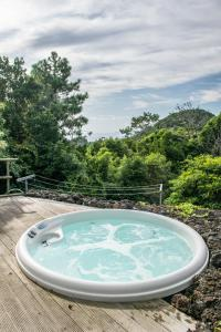 The swimming pool at or near Aldeia Dos Caldeirões