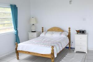 A bed or beds in a room at Villa Benito