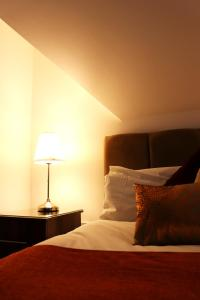 A bed or beds in a room at Breck Blackpool