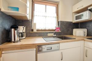 A kitchen or kitchenette at Edelweiß
