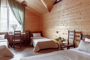 A bed or beds in a room at Tourist Complex belaya Reka Dakhovskaya