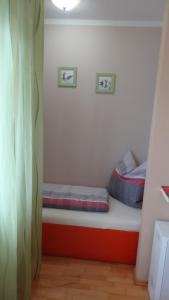 A bed or beds in a room at Apartment Viktoria
