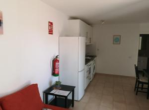 A kitchen or kitchenette at Caleta de Fuste Luxury Apartment